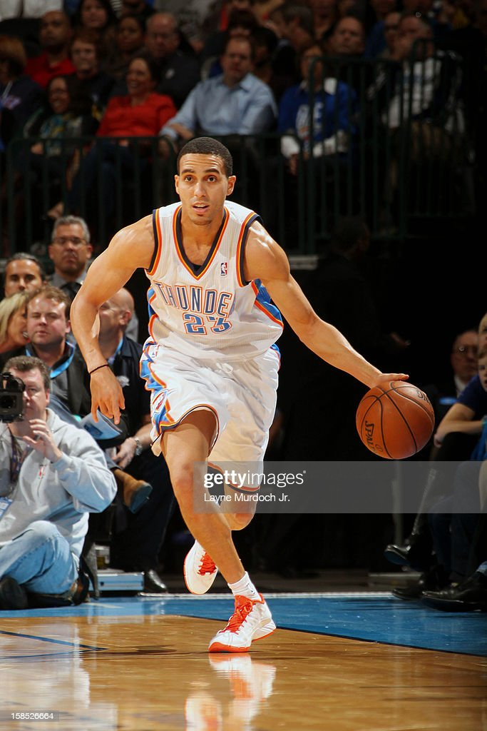 <a gi-track='captionPersonalityLinkClicked' href=/galleries/search?phrase=Kevin+Martin+-+Basketball+Player&family=editorial&specificpeople=204503 ng-click='$event.stopPropagation()'>Kevin Martin</a> #23 of the Oklahoma City Thunder dribbles up the floor against the San Antonio Spurs during an NBA game on December 17, 2012 at the Chesapeake Energy Arena in Oklahoma City, Oklahoma.