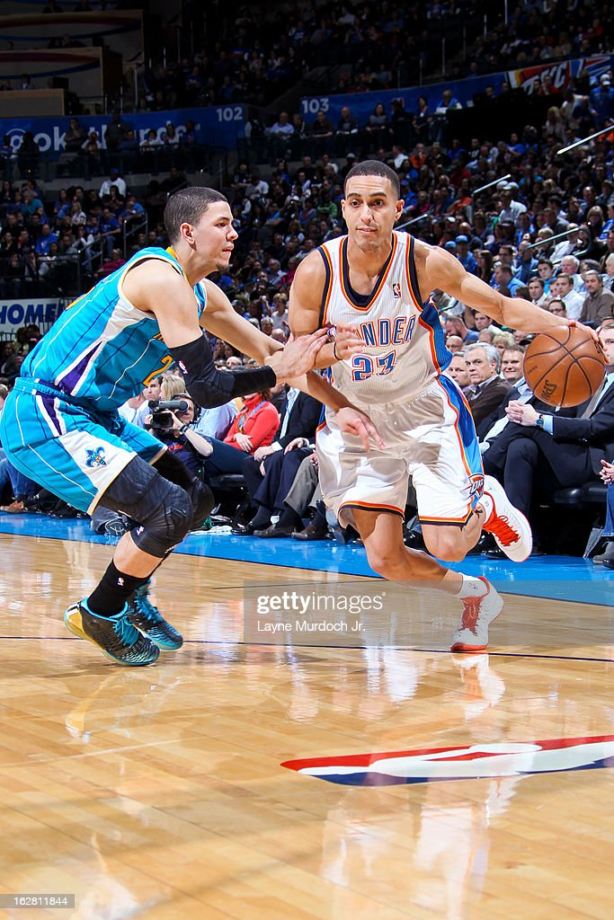 Kevin Martin #23 of the Oklahoma City Thunder drives against Austin Rivers #25 of the New Orleans Hornets on February 27, 2013 at the Chesapeake Energy Arena in Oklahoma City, Oklahoma.