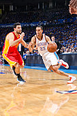 Kevin Martin of the Oklahoma City Thunder drives against Carlos Delfino of the Houston Rockets in Game Five of the Western Conference Quarterfinals...