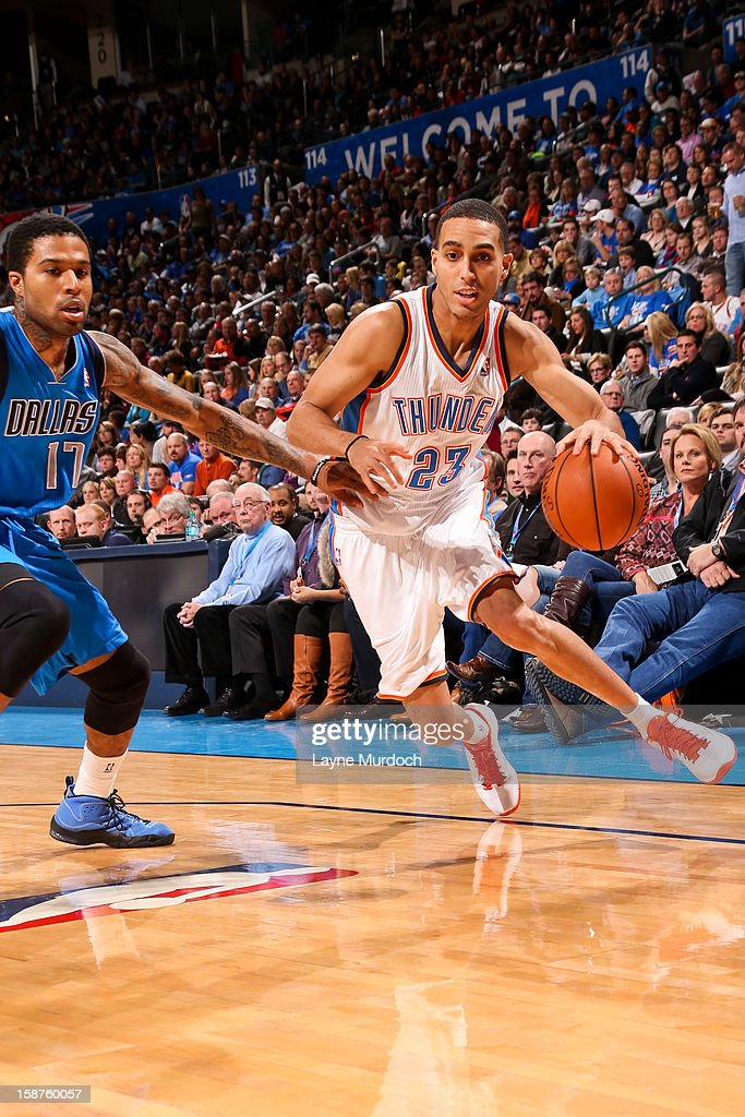 Kevin Martin #23 of the Oklahoma City Thunder drives against Chris Douglas-Roberts #17 of the Dallas Mavericks on December 27, 2012 at the Chesapeake Energy Arena in Oklahoma City, Oklahoma.