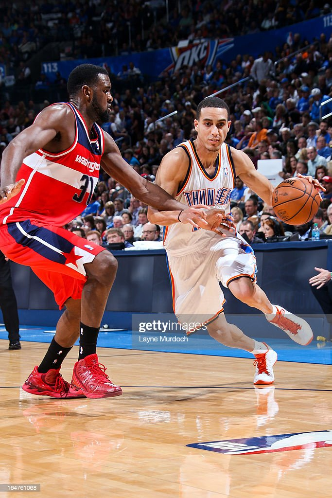Kevin Martin #23 of the Oklahoma City Thunder drives against Chris Singleton #31 of the Washington Wizards on March 27, 2013 at the Chesapeake Energy Arena in Oklahoma City, Oklahoma.