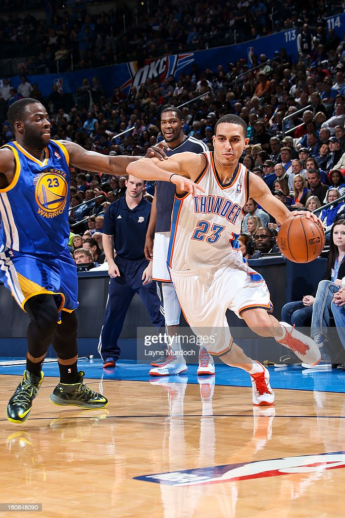Kevin Martin #23 of the Oklahoma City Thunder drives against Draymond Green #23 of the Golden State Warriors on February 6, 2013 at the Chesapeake Energy Arena in Oklahoma City, Oklahoma.