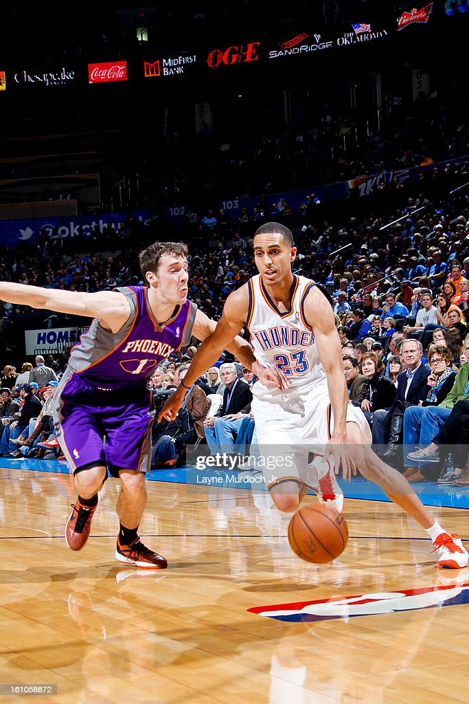 Kevin Martin #23 of the Oklahoma City Thunder drives against Goran Dragic #1 of the Phoenix Suns on February 8, 2013 at the Chesapeake Energy Arena in Oklahoma City, Oklahoma.