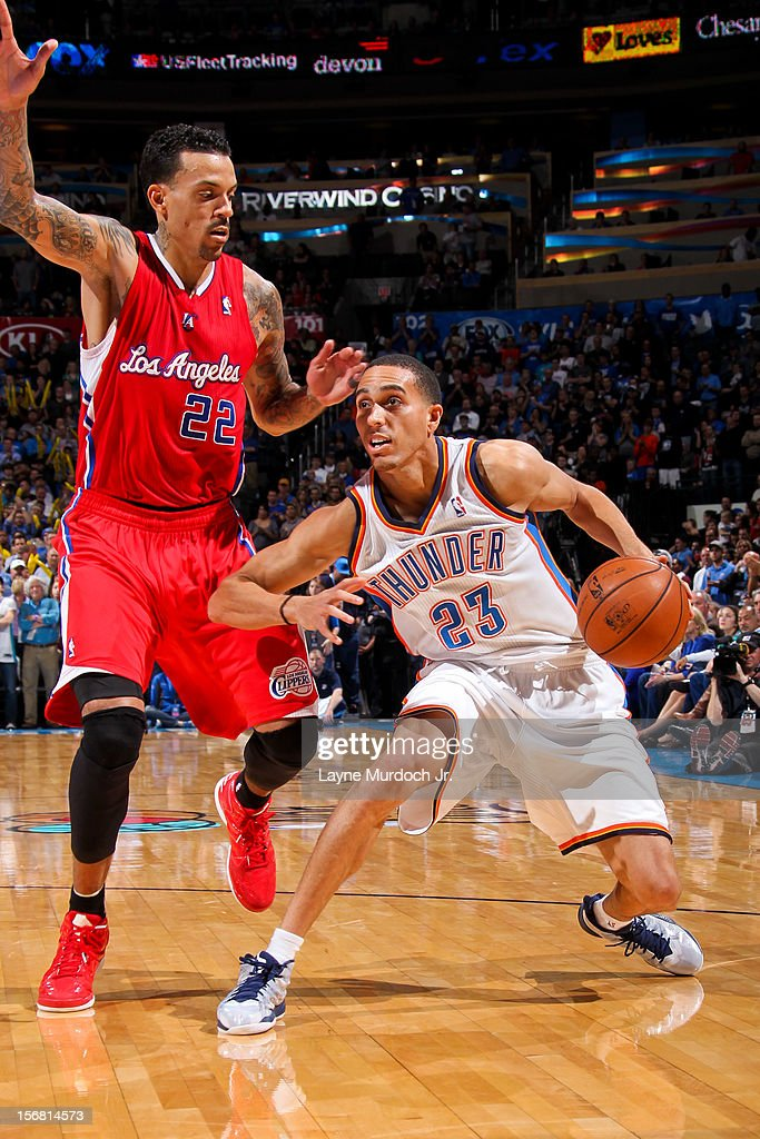 Kevin Martin #23 of the Oklahoma City Thunder drives against Matt Barnes #22 of the Los Angeles Clippers on November 21, 2012 at the Chesapeake Energy Arena in Oklahoma City, Oklahoma.