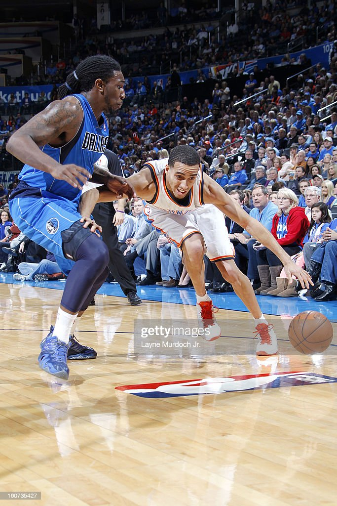 Kevin Martin #23 of the Oklahoma City Thunder drives to the basket against Jae Crowder #9 of the Dallas Mavericks on February 04, 2013 at the Chesapeake Energy Arena in Oklahoma City, Oklahoma.
