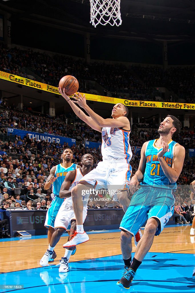 Kevin Martin #23 of the Oklahoma City Thunder drives to the basket against Greivis Vasquez #21 of the New Orleans Hornets on February 27, 2013 at the Chesapeake Energy Arena in Oklahoma City, Oklahoma.