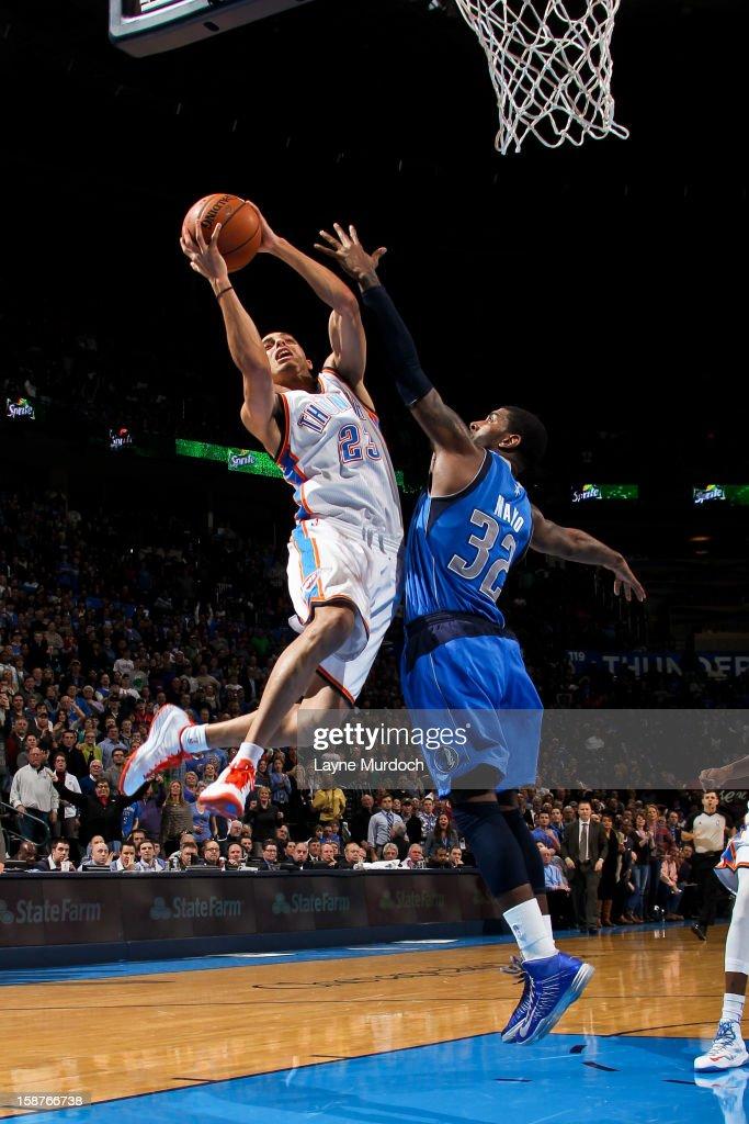 Kevin Martin #23 of the Oklahoma City Thunder drives to the basket against O.J. Mayo #32 of the Dallas Mavericks on December 27, 2012 at the Chesapeake Energy Arena in Oklahoma City, Oklahoma.