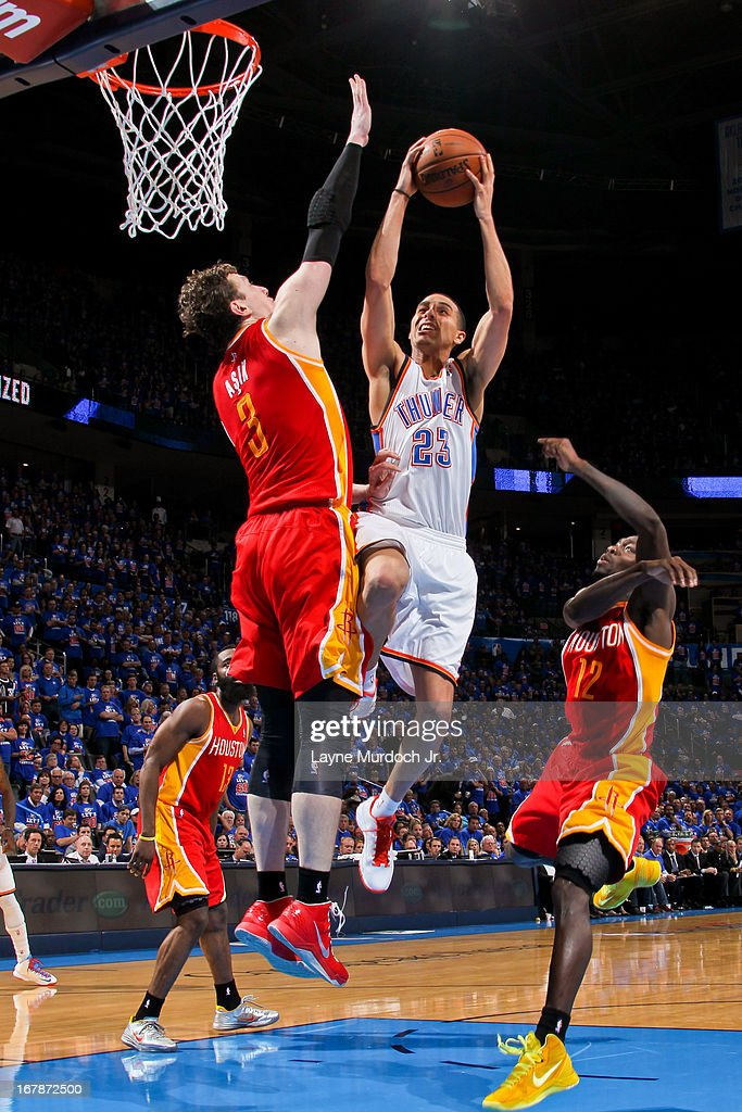 Kevin Martin #23 of the Oklahoma City Thunder drives to the basket against Omer Asik #3 of the Houston Rockets in Game Five of the Western Conference Quarterfinals during the 2013 NBA Playoffs on May 1, 2013 at the Chesapeake Energy Arena in Oklahoma City, Oklahoma.