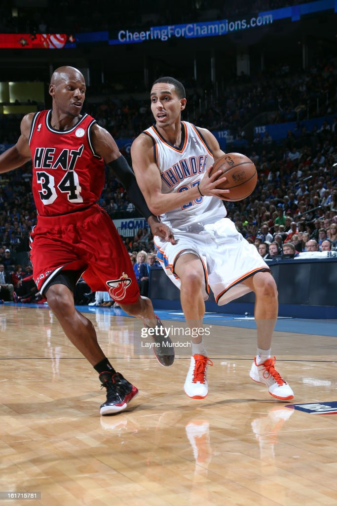 Kevin Martin #23 of the Oklahoma City Thunder drives to the hoop against Ray Allen #34 of the Miami Heat during an NBA game on February 14, 2013 at the Chesapeake Energy Arena in Oklahoma City, Oklahoma.