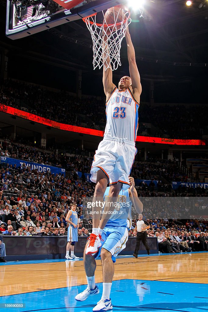 Kevin Martin #23 of the Oklahoma City Thunder dunks against the Denver Nuggets on January 16, 2013 at the Chesapeake Energy Arena in Oklahoma City, Oklahoma.