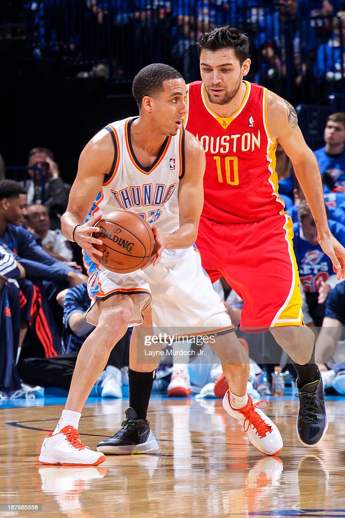 Kevin Martin #23 of the Oklahoma City Thunder looks to pass the ball against Carlos Delfino #10 of the Houston Rockets in Game Five of the Western Conference Quarterfinals during the 2013 NBA Playoffs on May 1, 2013 at the Chesapeake Energy Arena in Oklahoma City, Oklahoma.