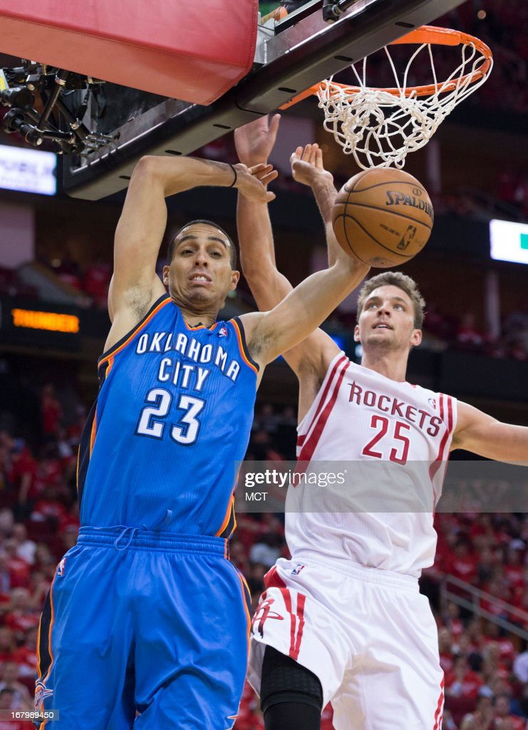 Kevin Martin (23) of the Oklahoma City Thunder puts down a dunk in front of Chandler Parsons (25) of the Houston Rockets in the second half of their Western Conference playoff game game on Friday, May 3, 2013, in Houston, Texas.