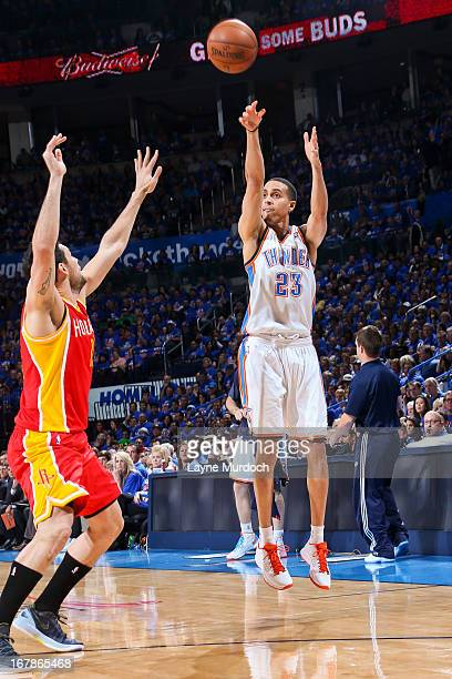Kevin Martin of the Oklahoma City Thunder shoots a threepointer against Carlos Delfino of the Houston Rockets in Game Five of the Western Conference...