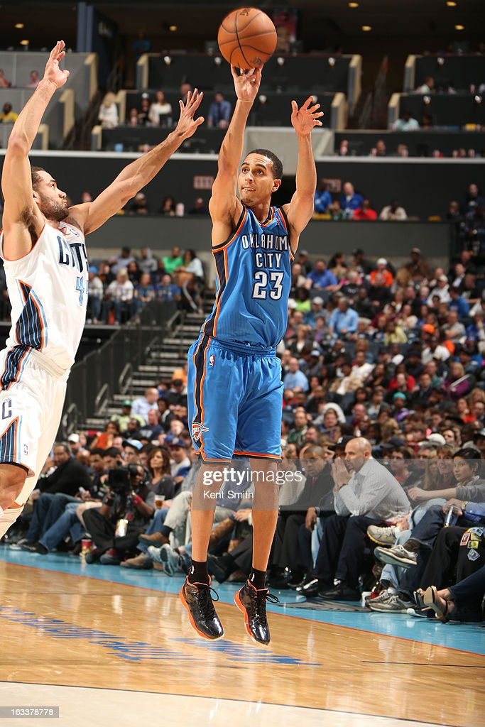 Kevin Martin #23 of the Oklahoma City Thunder shoots against Jeffery Taylor #44 of the Charlotte Bobcats at the Time Warner Cable Arena on March 8, 2013 in Charlotte, North Carolina.