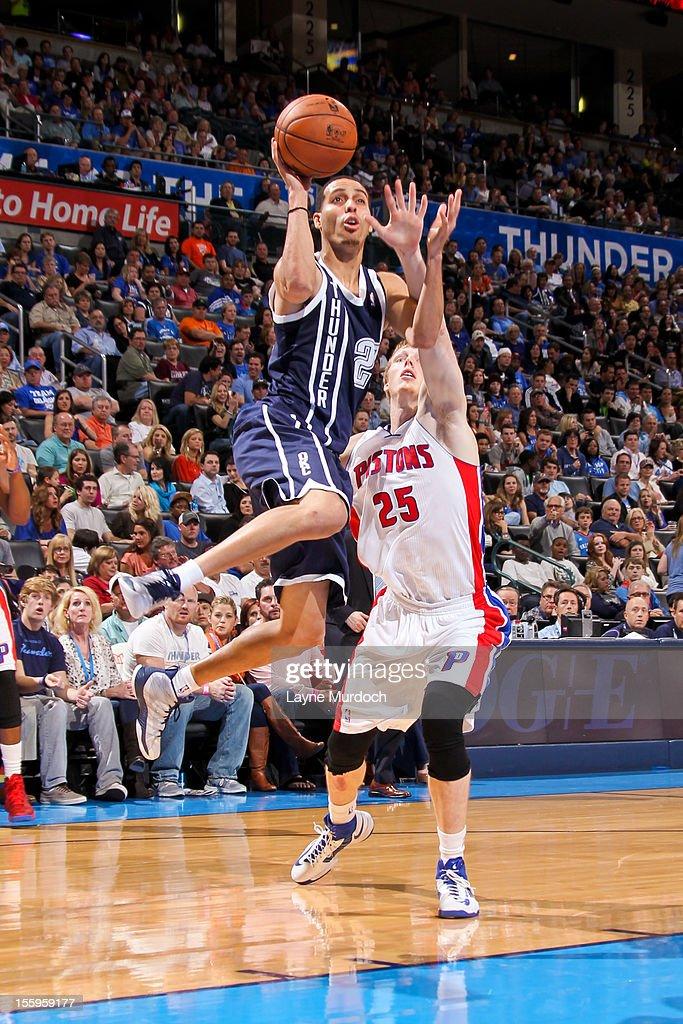 Kevin Martin #23 of the Oklahoma City Thunder shoots against Kyle Singler #25 of the Detroit Pistons on November 9, 2012 at the Chesapeake Energy Arena in Oklahoma City, Oklahoma.