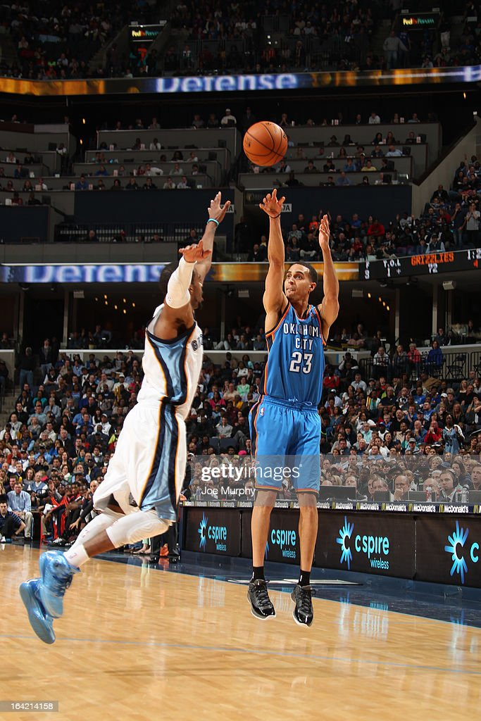 Kevin Martin #23 of the Oklahoma City Thunder shoots against Mike Conley #11 of the Memphis Grizzlies on March 20, 2013 at FedExForum in Memphis, Tennessee.