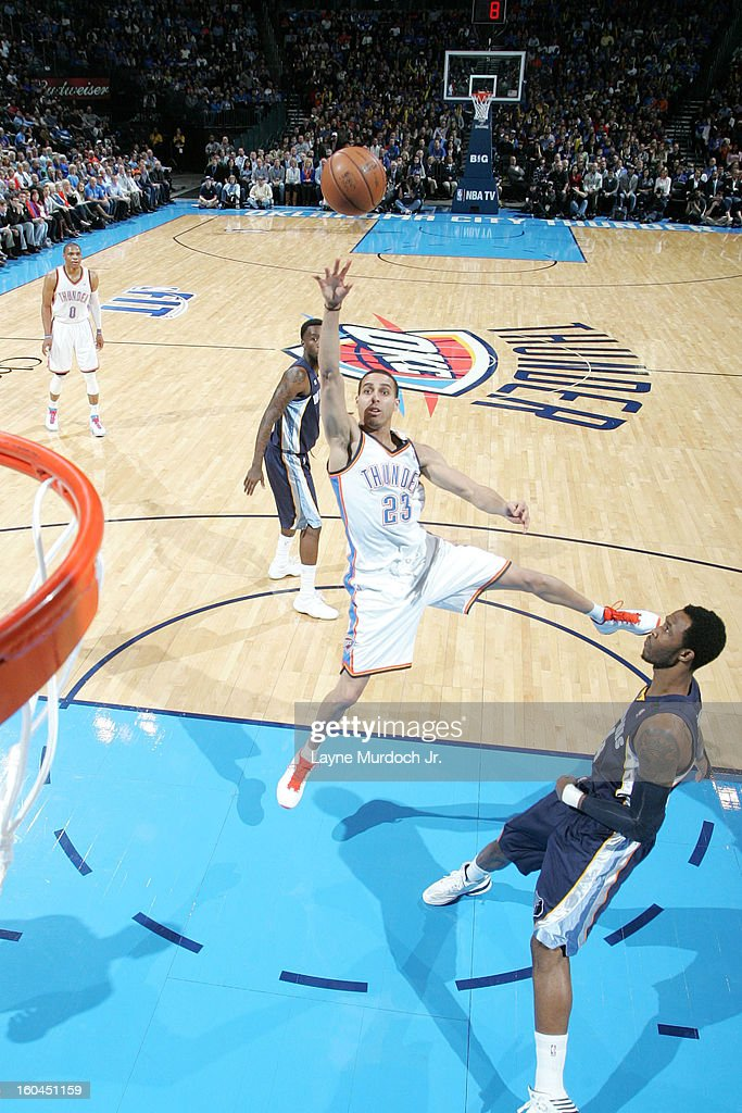 Kevin Martin #23 of the Oklahoma City Thunder shoots an off balance shot over xthe Memphis Grizzlies during an NBA game on January 31, 2013 at the Chesapeake Energy Arena in Oklahoma City, Oklahoma.