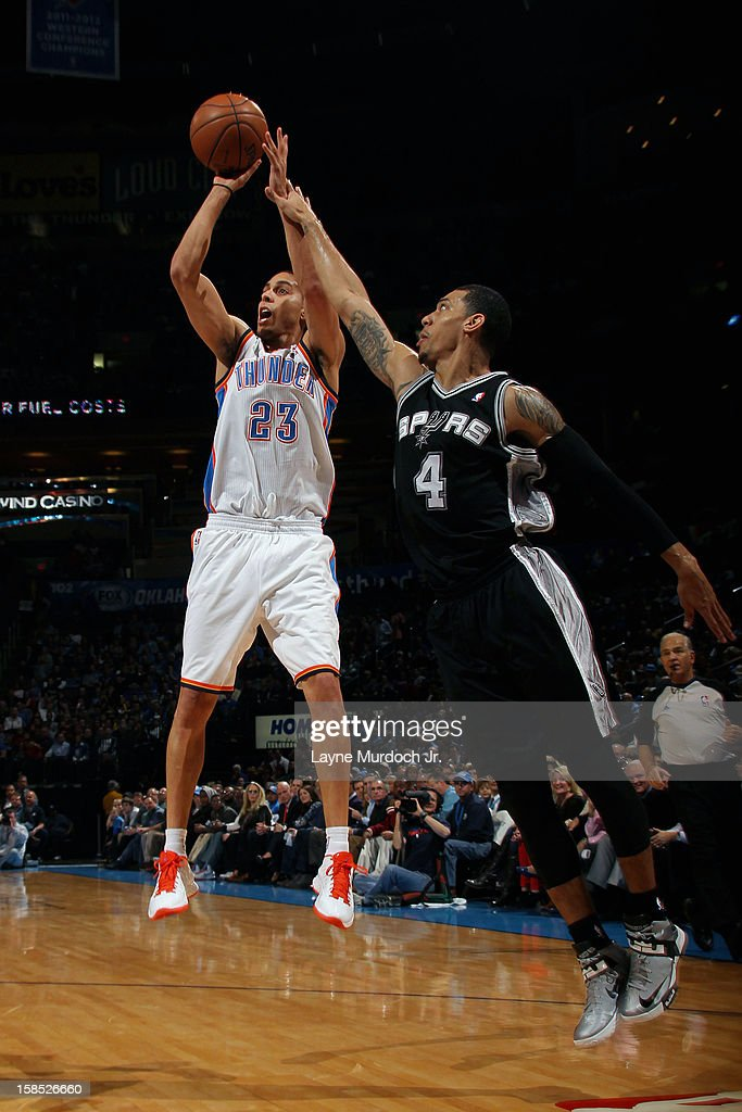 <a gi-track='captionPersonalityLinkClicked' href=/galleries/search?phrase=Kevin+Martin+-+Basketball+Player&family=editorial&specificpeople=204503 ng-click='$event.stopPropagation()'>Kevin Martin</a> #23 of the Oklahoma City Thunder shoots over Danny Green #4 of the San Antonio Spurs during an NBA game on December 17, 2012 at the Chesapeake Energy Arena in Oklahoma City, Oklahoma.