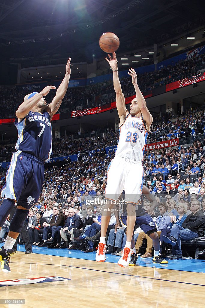 Kevin Martin #23 of the Oklahoma City Thunder shoots over Jerryd Bayless #7 of the Memphis Grizzlies during an NBA game on January 31, 2013 at the Chesapeake Energy Arena in Oklahoma City, Oklahoma.