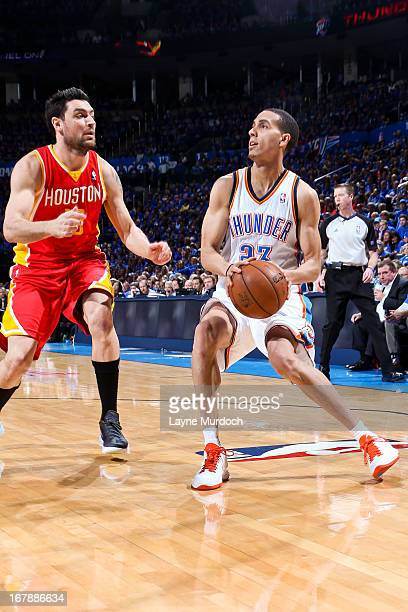 Kevin Martin of the Oklahoma City Thunder squares to shoot against Carlos Delfino of the Houston Rockets in Game Five of the Western Conference...