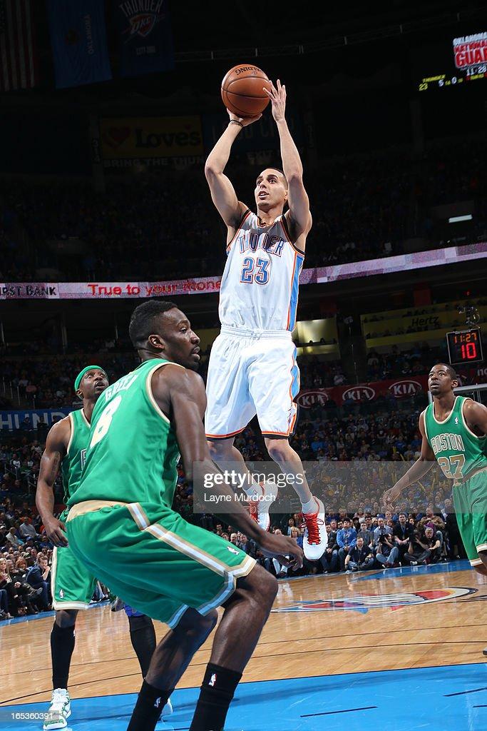 Kevin Martin #23 of the Oklahoma City Thunder takes a shot against the Boston Celtics on March 10, 2013 at the Chesapeake Energy Arena in Oklahoma City, Oklahoma.
