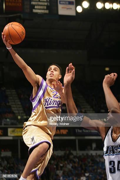 Kevin Martin of the Sacramento Kings drives to the basket around CJ Miles of the Utah Jazz on November 15 2005 at ARCO Arena in Sacramento California...