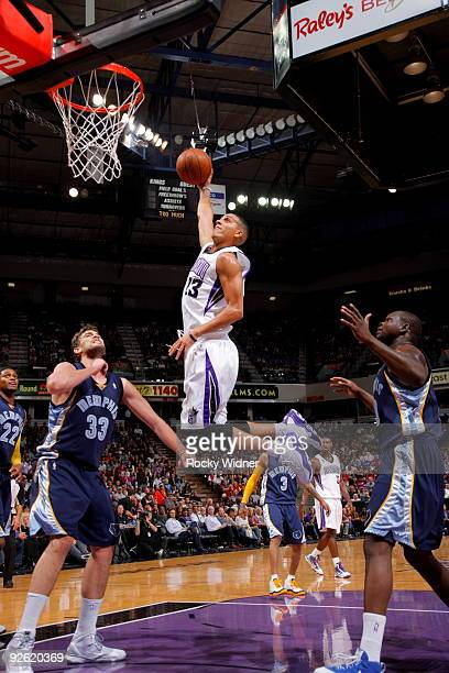 Kevin Martin of the Sacramento Kings drives to the basket for a dunk against Marc Gasol of the Memphis Grizzies on November 2 2009 at ARCO Arena in...