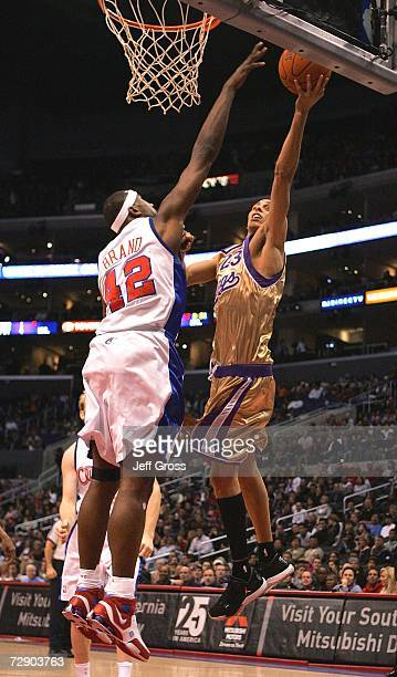 Kevin Martin of the Sacramento Kings drives to the basket over Elton Brand of the Los Angeles Clippers during the first half of the game on December...