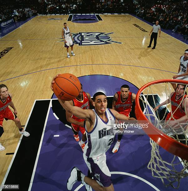 Kevin Martin of the Sacramento Kings elevates to the basket for a dunk during a game against The Golden State Warriors at Arco Arena on December 30...