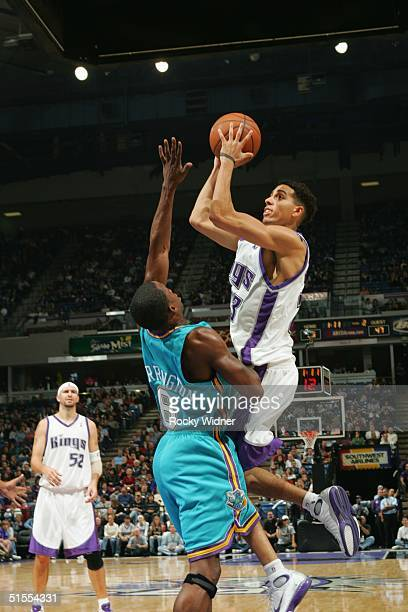 Kevin Martin of the Sacramento Kings takes the ball to the basket against Junior Harrington of the New Orleans Hornets during the game on October 23...