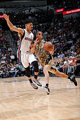 Kevin Martin of the San Antonio Spurs drives to the basket against Gerald Green of the Miami Heat during the game on March 23 2016 at ATT Center in...