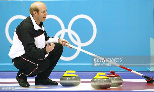 Kevin Martin the skip for the Canada's curling team points his thumb in the direction he hopes the stone will move 15 February 2002 during his team's...