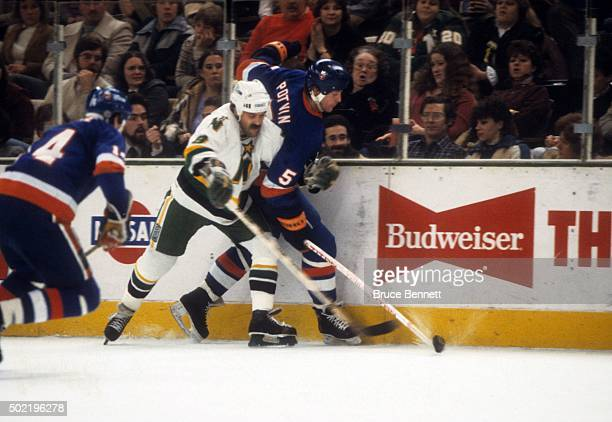 Kevin Maxwell of the Minnesota North Stars checks Denis Potvin of the New York Islanders during the 1981 Stanley Cup Finals in May 1981 at the Met...