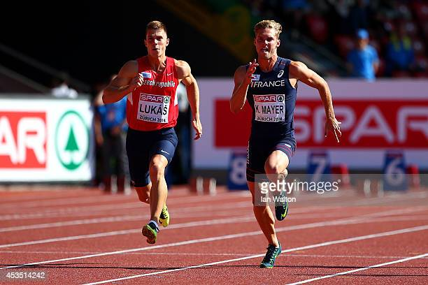 Kevin Mayer of France and Marek Lukas of the Czech Republic compete in the competes in the Men's Decathlon 100 metres during day one of the 22nd...
