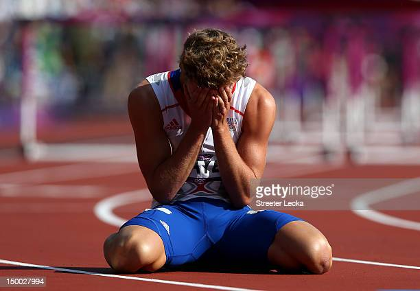 Kevin Mayer of France sits on the track after competing during the Men's Decathlon 110m Hurdles heats on Day 13 of the London 2012 Olympic Games at...
