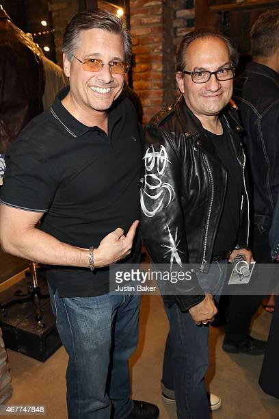 Kevin Mazur poses with Neal Krone who shows off his jacket signed by Kevin while attending 'A Tribute To Rock Roll' hosted by Schott NYC Featuring...