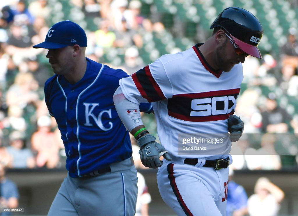 Kevin McCarthy #61 of the Kansas City Royals tags out Kevan Smith #36 of the Chicago White Sox during the seventh inning on September 24, 2017 at Guaranteed Rate Field in Chicago, Illinois.