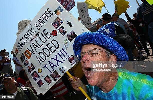 Kevin McCracken holds a sign during a Tea Party Protest in Freedom Plaza April 15 2010 in Washington DC The event titled the People�s Tax Revolt...