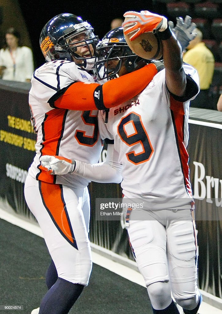 Kevin McCullough #50 of the Spokane Shock celebrates in the end zone with Sergio Gilliam #9 after Gilliam returned an interception for a touchdown during the Shock's 74-27 victory over the Wilkes-Barre/Scranton Pioneers in the AFL2 ArenaCup 10 at the Orleans Arena August 22, 2009 in Las Vegas, Nevada.