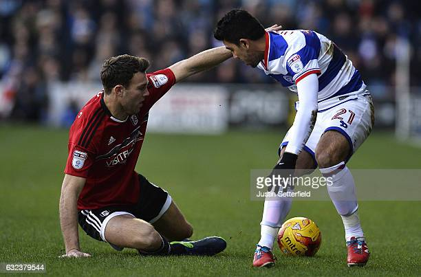 Kevin McDonald of Fulham FC and Massimo Luongo of Queens Park Rangers in action during the Sky Bet Championship match between Queens Park Rangers and...