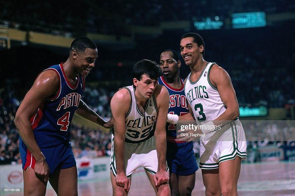 Kevin McHale and Dennis Johnson of the Boston Celtics stand against Rick Mahorn and Vinnie Johnson and the Detroit Pistons during a game played in...