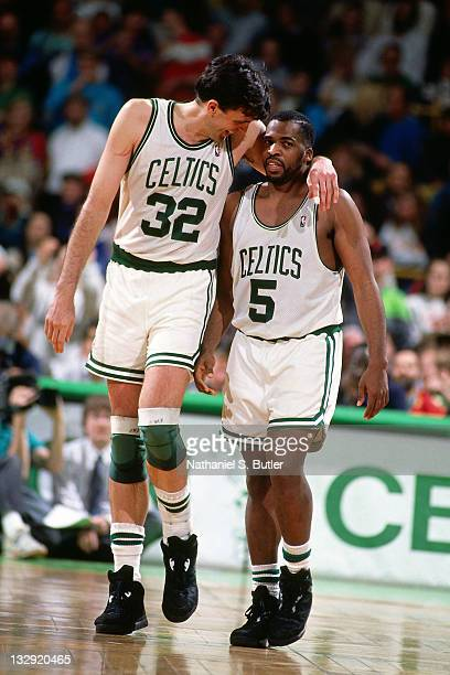 Kevin McHale and John Bagley of the Boston Celtics talk at the Boston Garden in Boston Massachusetts circa 1991 NOTE TO USER User expressly...
