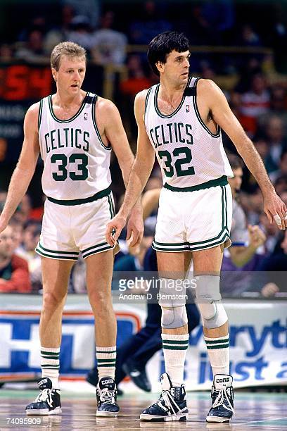 Kevin Mchale and Larry Bird of the Boston Celtics play defense during a game played in 1989 at the Boston Garden in Boston Massachusetts NOTE TO USER...