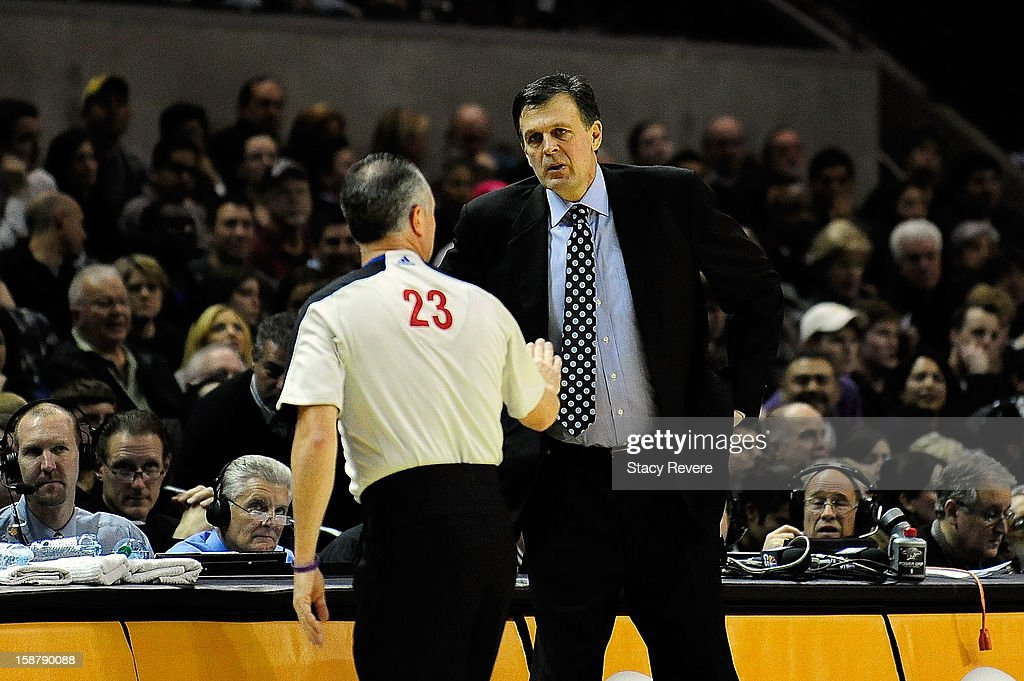 Kevin McHale, head coach of the Houston Rockets discusses a call with game official Jason Phillips during a game against the San Antonio Spurs at AT&T Center on December 28, 2012 in San Antonio, Texas.