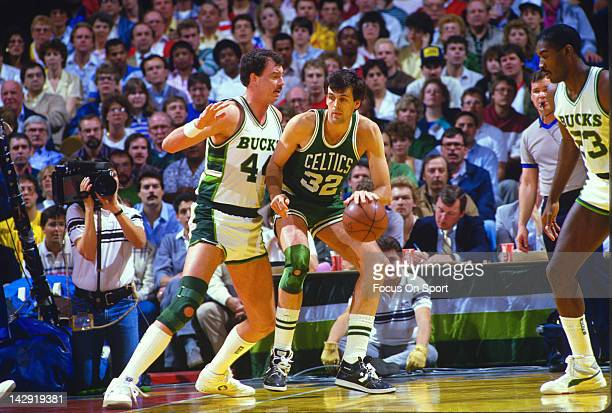 Kevin McHale of the Boston Celtics backs in on Paul Mokeski of the Milwaukee Bucks during an NBA basketball game circa 1985 at the MECCA Arena in...