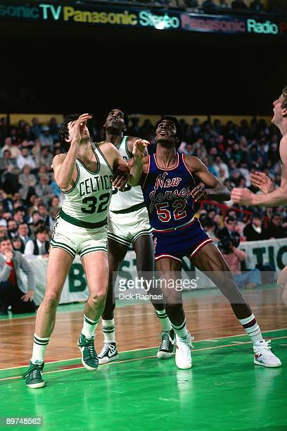 Kevin McHale of the Boston Celtics battles for position against Buck Williams of the the New Jersey Nets during a game played in 1982 at the Boston...