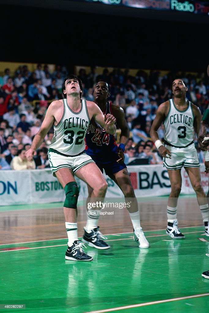 Kevin McHale of the Boston Celtics battles for rebound position against Rick Mahorn of the Detroit Pistions Dennis Johnson of the Boston Celtics also...