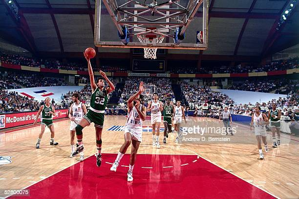 Kevin McHale of the Boston Celtics drives to the basket against Real Madrid during the 1988 McDonald's Open circa 1988 in Madrid Spain NOTE TO USER...