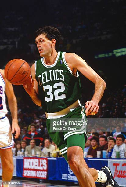 Kevin McHale of the Boston Celtics drives to the basket against the Philadelphia 76ers during an NBA basketball game circa 1984 at the Spectrum in...
