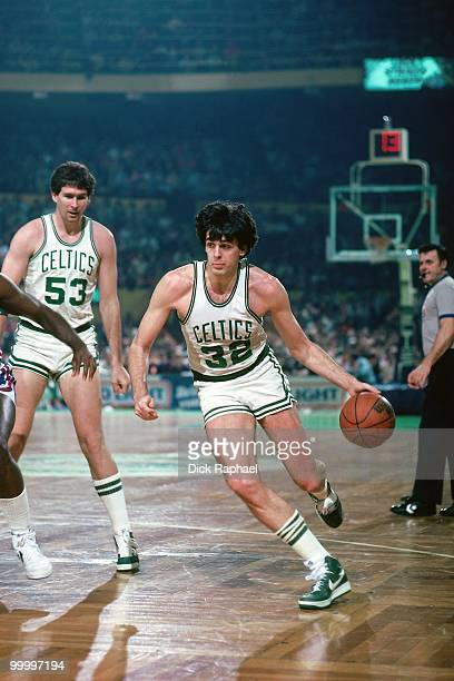 Kevin McHale of the Boston Celtics drives to the basket during a game played in 1983 at the Boston Garden in Boston Massachusetts NOTE TO USER User...
